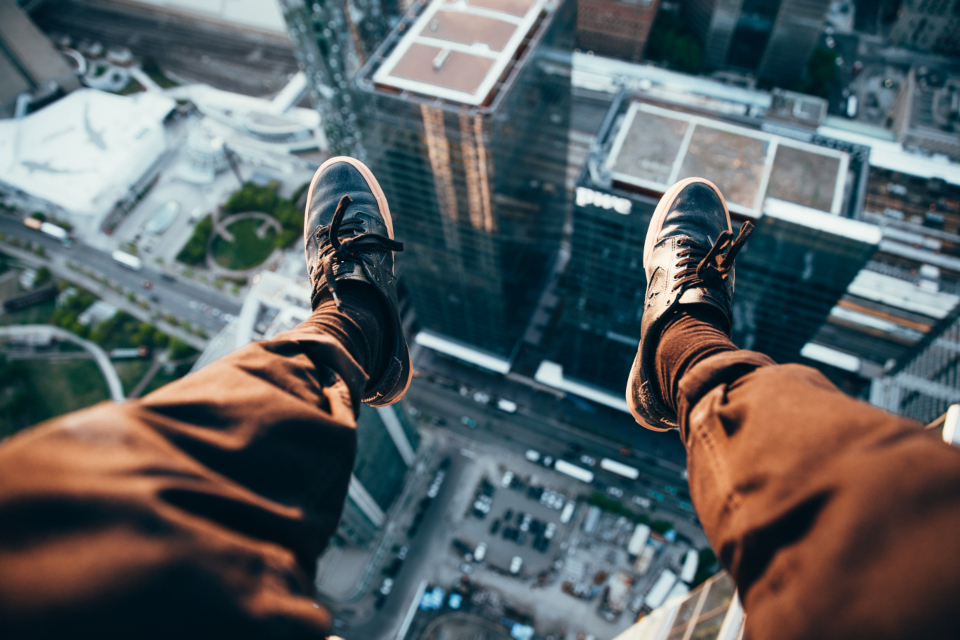legs architecture skyscraper dangerous scary trainers sneakers man people street high building