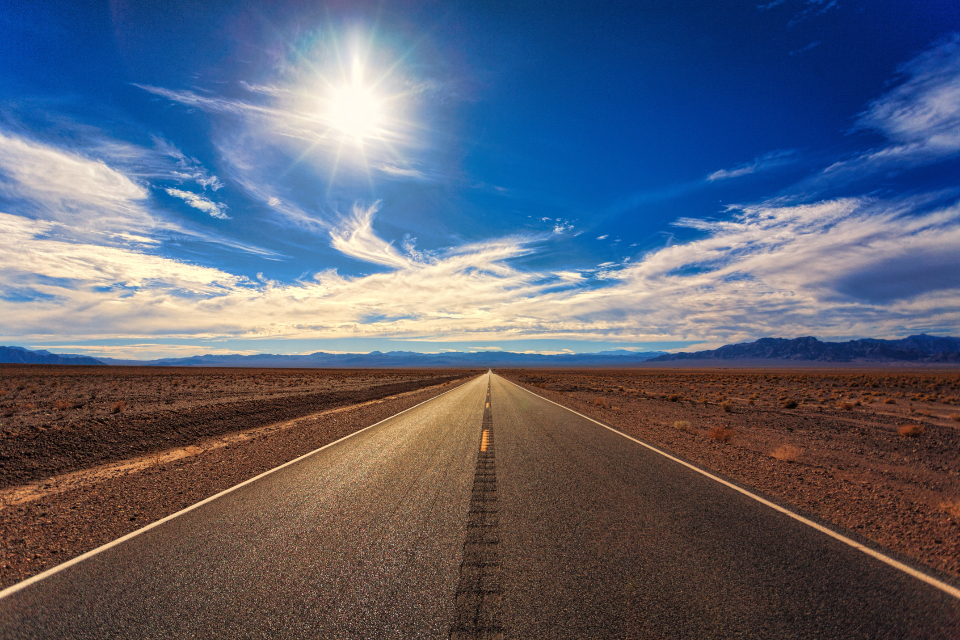 lonely road desert sand rocs dirt nature concrete asphalt blue sky clouds travel