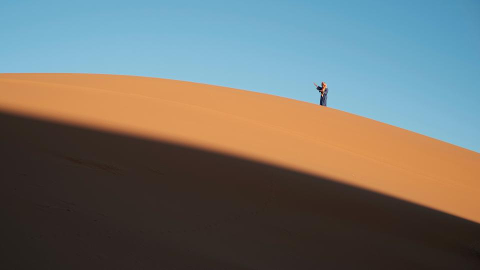 desert landscape sunny highland mountain blue sky people man alone