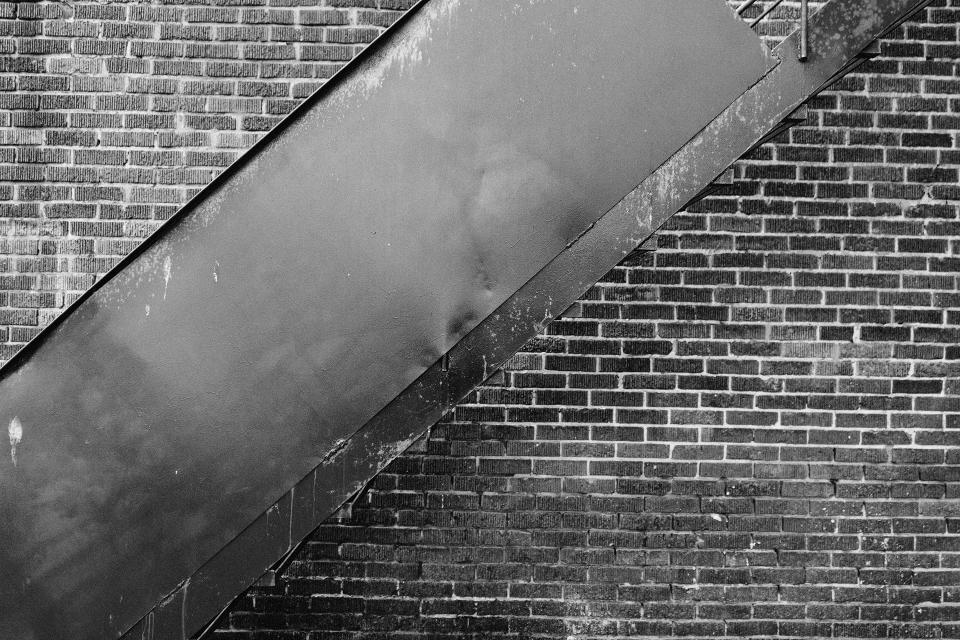 bricks wall staircase black and white city urban