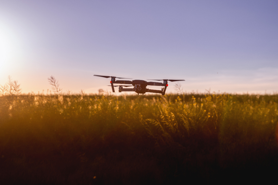 large drone sunset field sun farm wheat barley camera fly transport technology video rotate