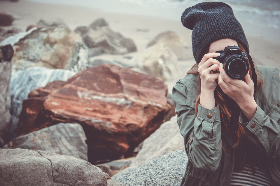 beach camera canon dslr girl outdoors person picture taking rocks stones taking photo water woman sand