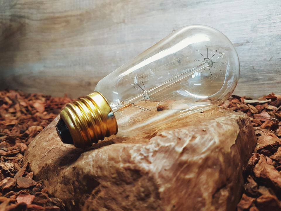 bulb light spark lamp rock stone