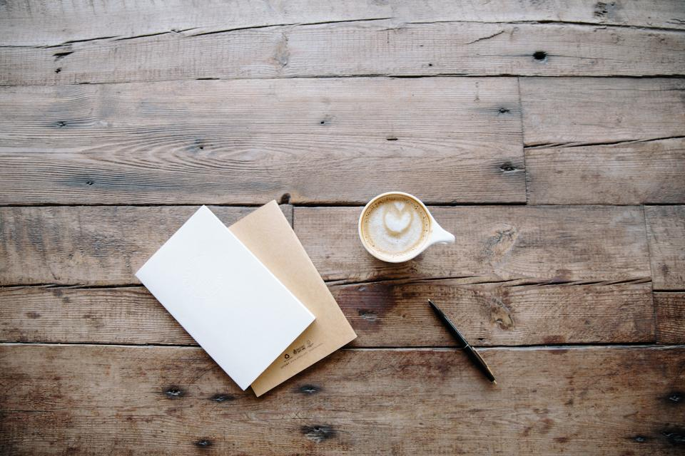 notepad notebook journal pen writing cafe coffee latte cappuccino wood