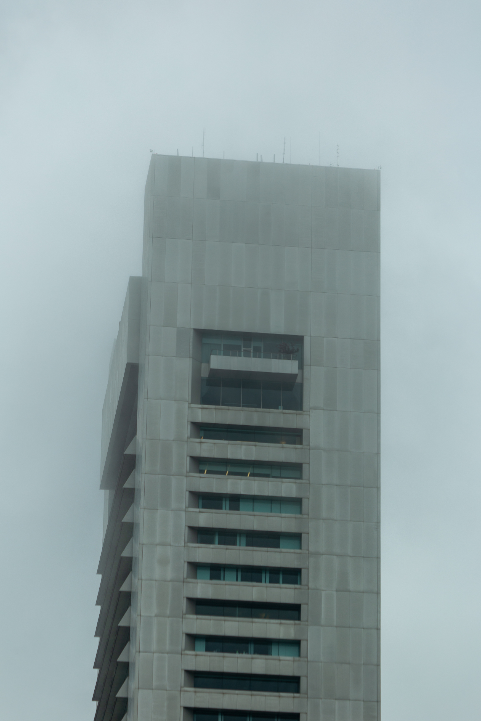 building fog city mist tower moody weather climate air cloudy urban tall perspective architecture exterior design