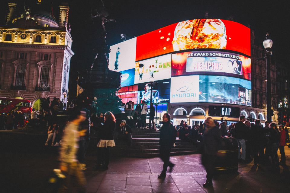 Piccadilly Circus people crowd busy city urban billboards lights dark night London