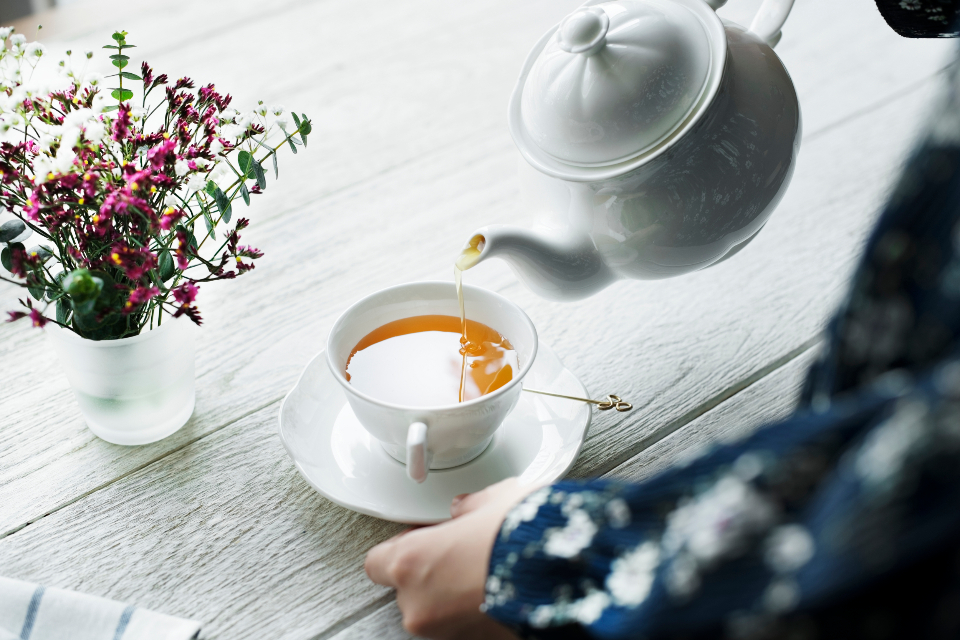 pouring tea cup afternoon beverage break cafe close up decoration drink enjoying feminine flower hand home hot drink lifestyle morning person simple minimal refreshment relax