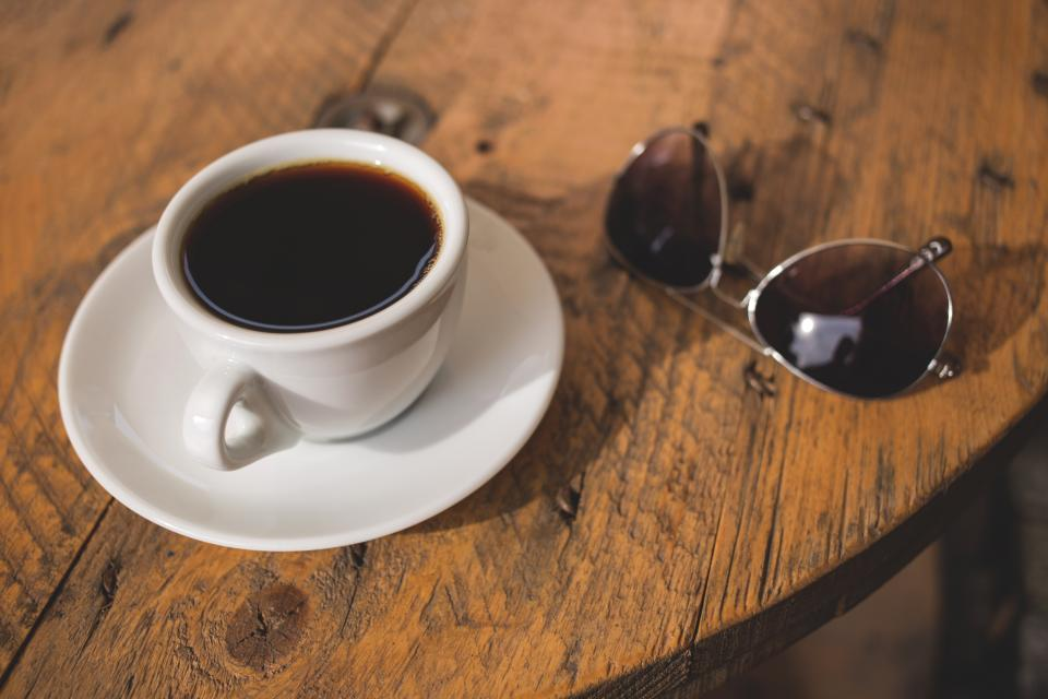espresso coffee cup table wood sunglasses