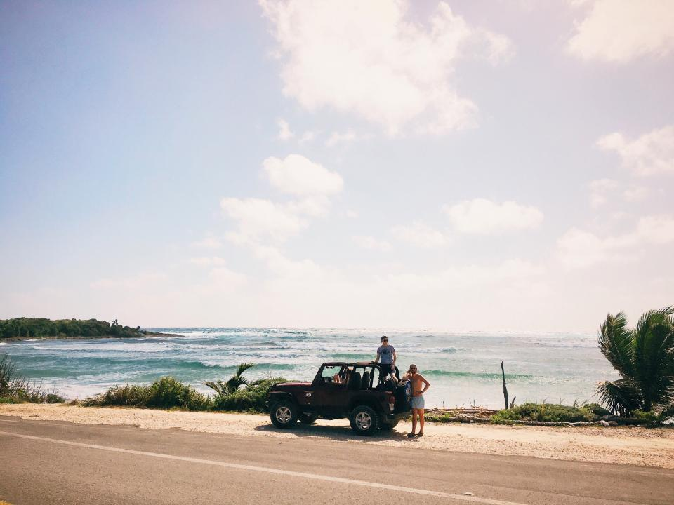 sea clouds nature trees jeep adventure trip travel people wave grass road men guys sunglasses water