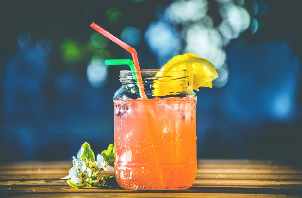 glass juice lemon fruit garnish cold drinks beverage ice straw flower chill bar bokeh