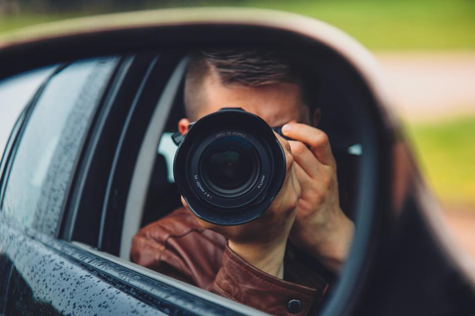 camera photographer photography lens mirror guy man people car