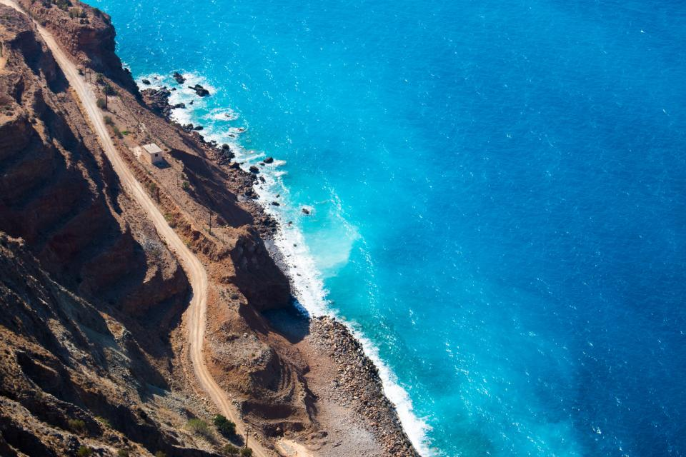 blue water ocean sea waves shore road trail coast mountain travel trip nature aerial view