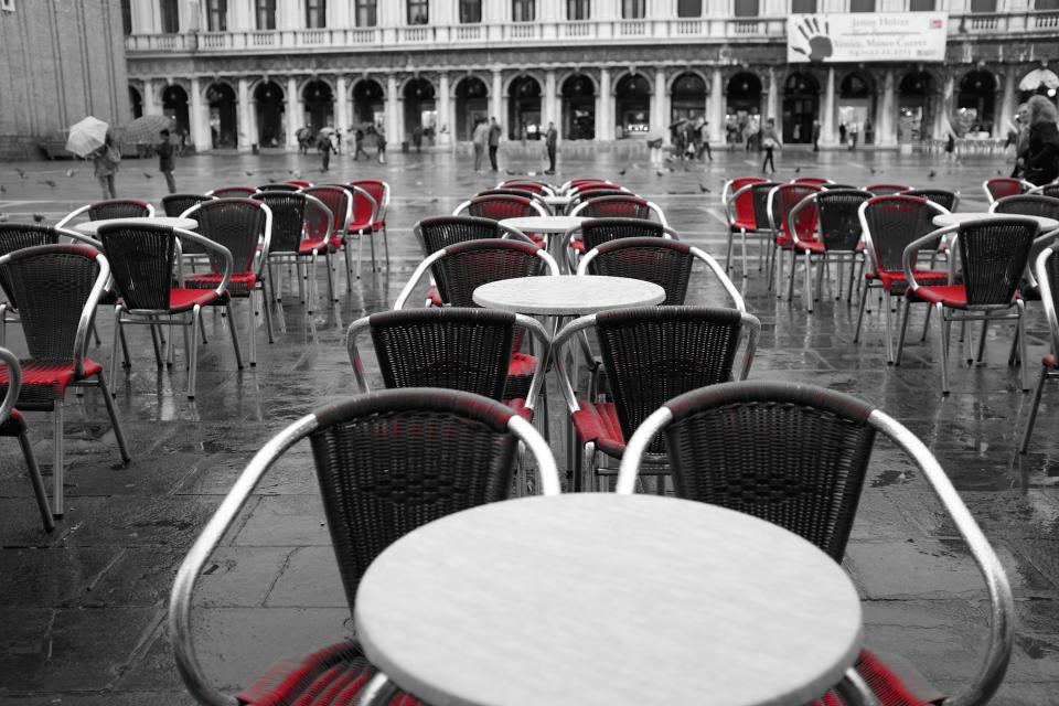 restaurant tables chairs terrace patio red black and white Piazza San Marco Venice Italy