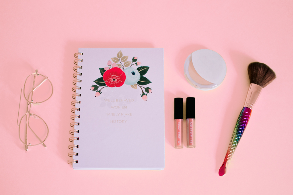 feminine notepad pink makeup brush glasses spectacles lipstick background minimal