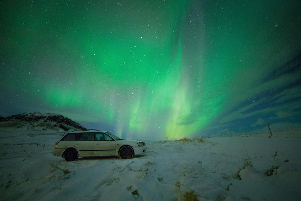 green aurora borealis nature stars constellation stargazing dark night car vehicle travel transportation