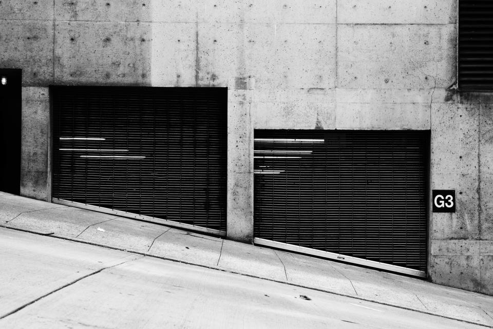 street road sidewalk concrete city urban black and white