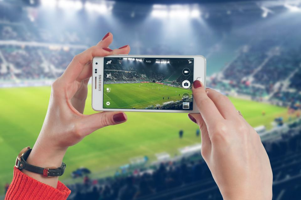 samsung smartphone mobile camera picture photograph photography photographer hands nail polish soccer sports field stadium lights