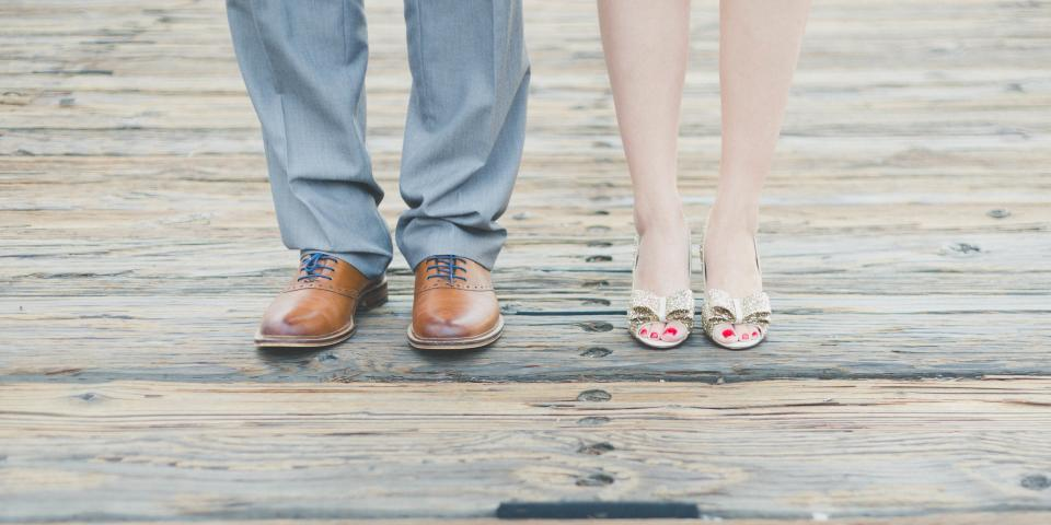 people man woman couple formal sandals leather shoes wood floor
