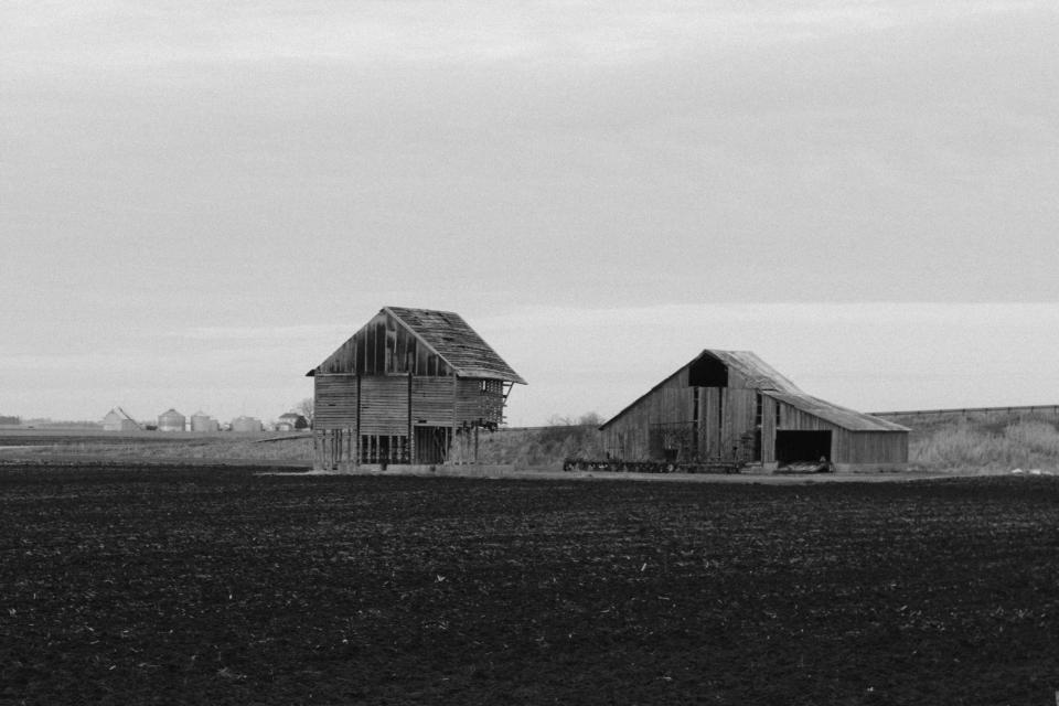 black and white hut house rural outdoor field nature sky