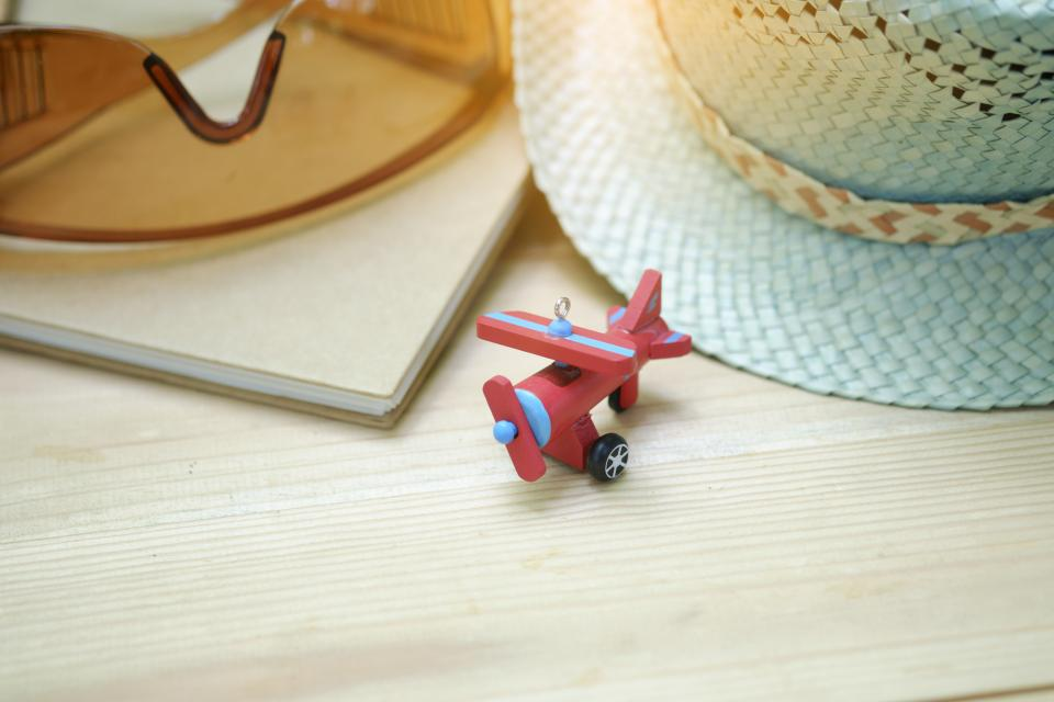 airplane toy eyeglasses hat cap table