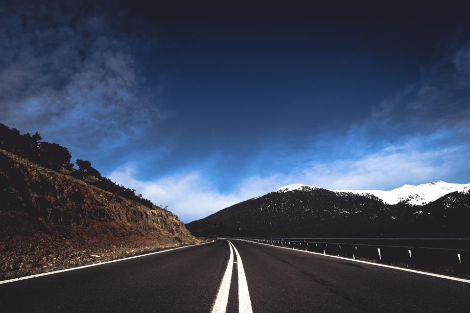 road path mountain highland landscape travel outdoor view blue sky cloud