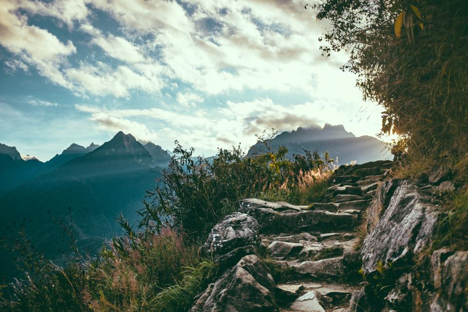 nature landscape mountains summit peaks steps stairs rocks plants vegetation sky clouds horizon rays light leaks
