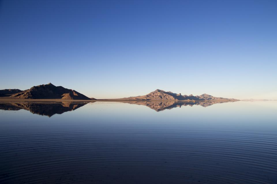 blue sky water reflection mountains landscape