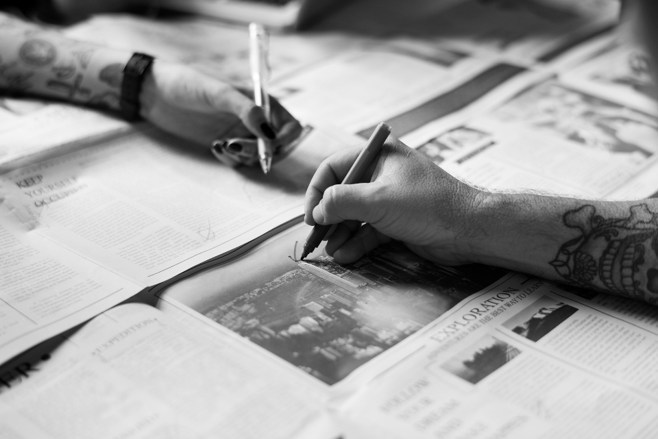 news paper pens publication table tattoo two writing bw black and white b&w