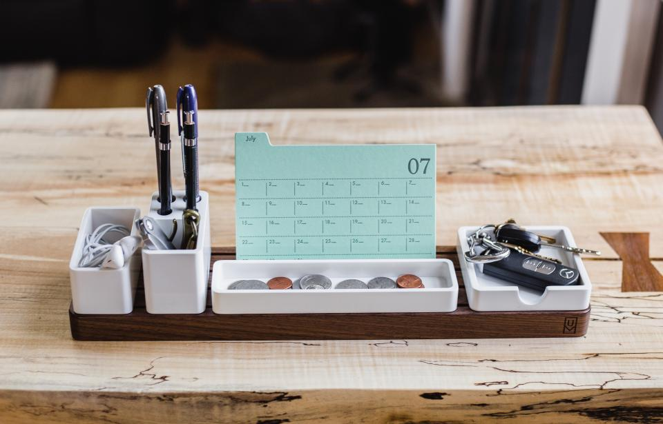 calendar display pens key earphones coins accessories wooden table interior