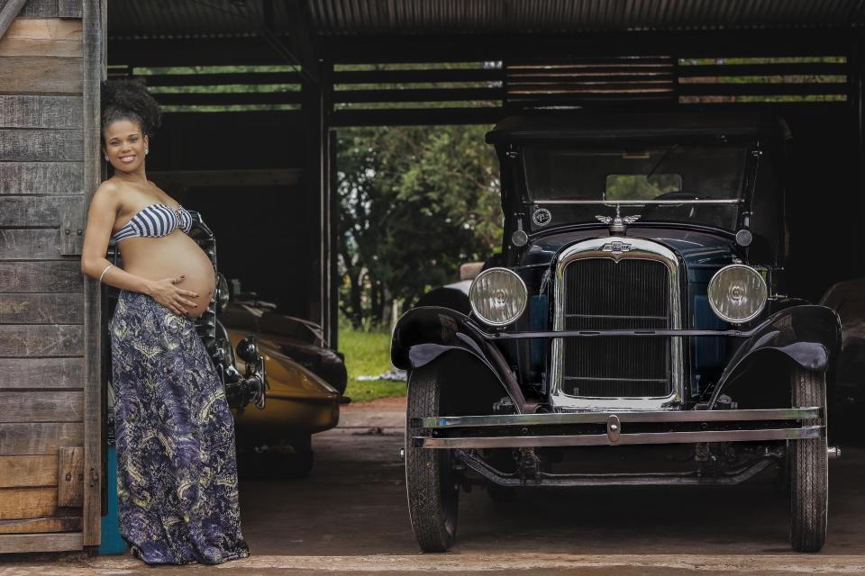 car vehicle transportation vintage old garage woman african american pregnan mother smile proud fashion model beauty