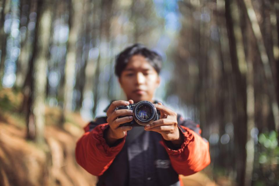 camera lens photography photo photographer people man woods forest