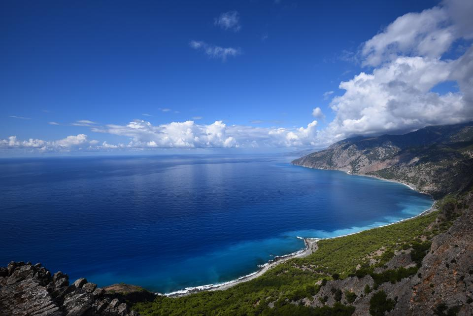 blue ocean sea sky clouds blue white green grass nature trip adventure