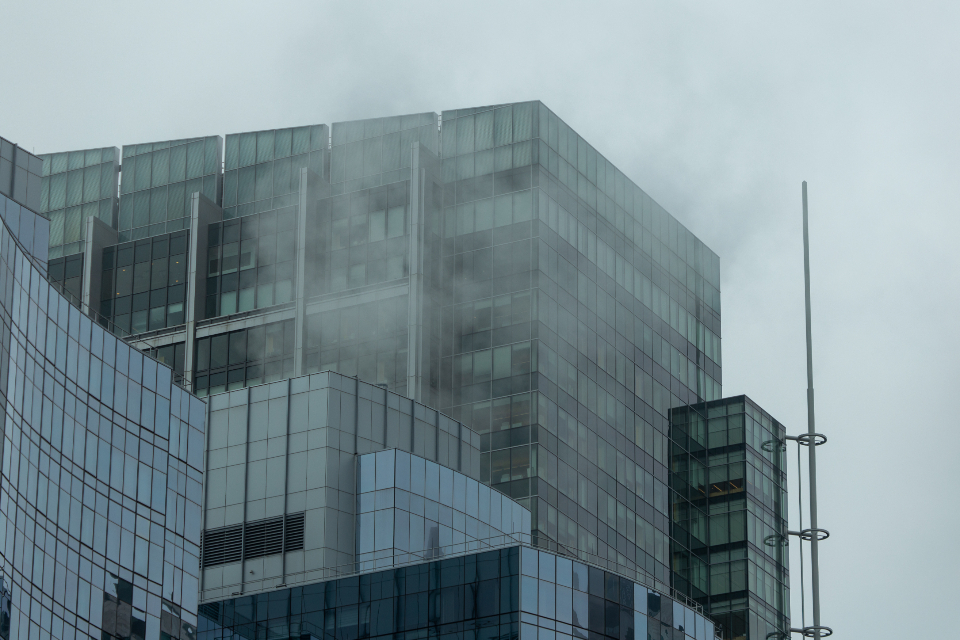 city fog mist glass moody weather climate air cityscape cloudy urban business building windows reflection