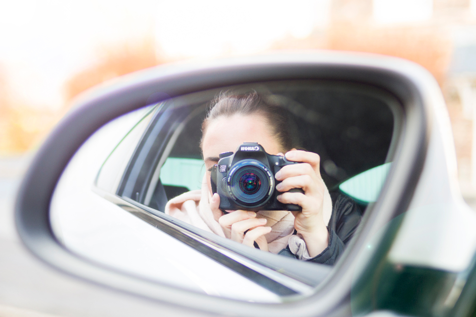 woman photograph mirror car transport photographer people dslr reflection car mirror