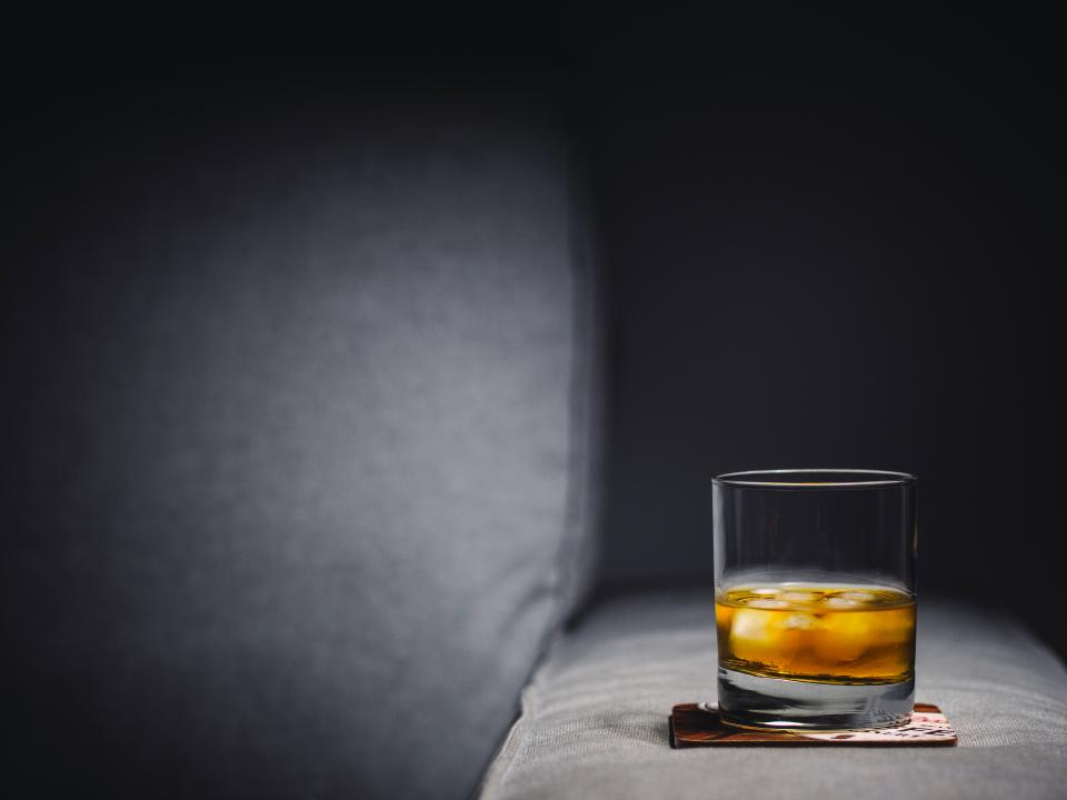 whisky alcohol drink on the rocks glass ice cubes coaster