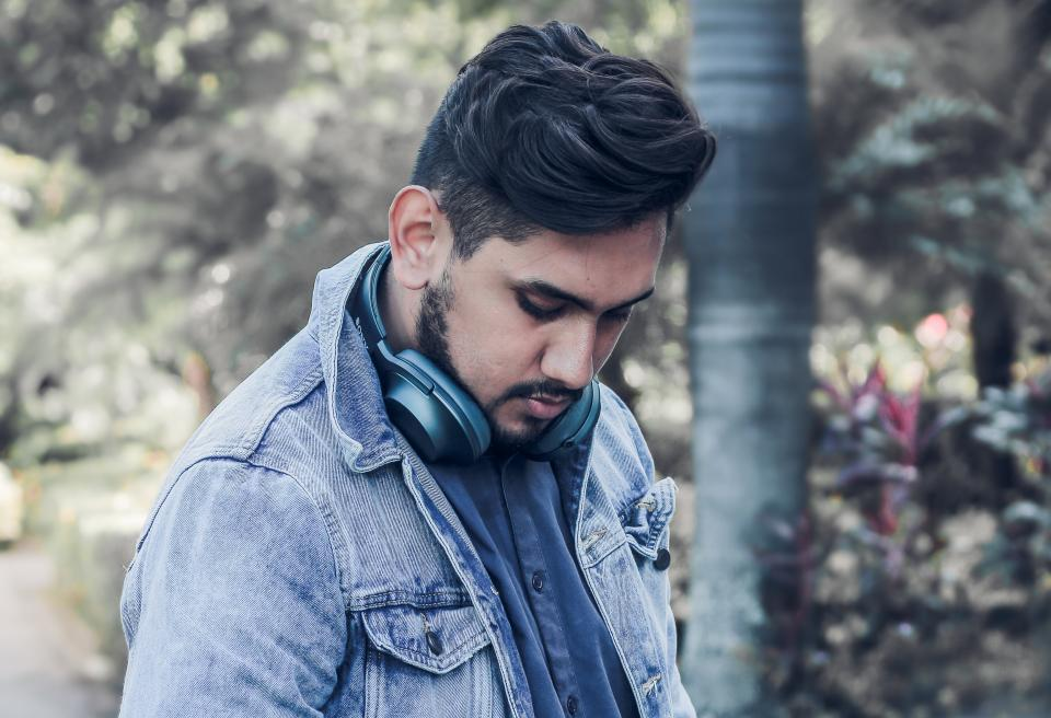 people man guy denim jacket headphone blur outdoor outside
