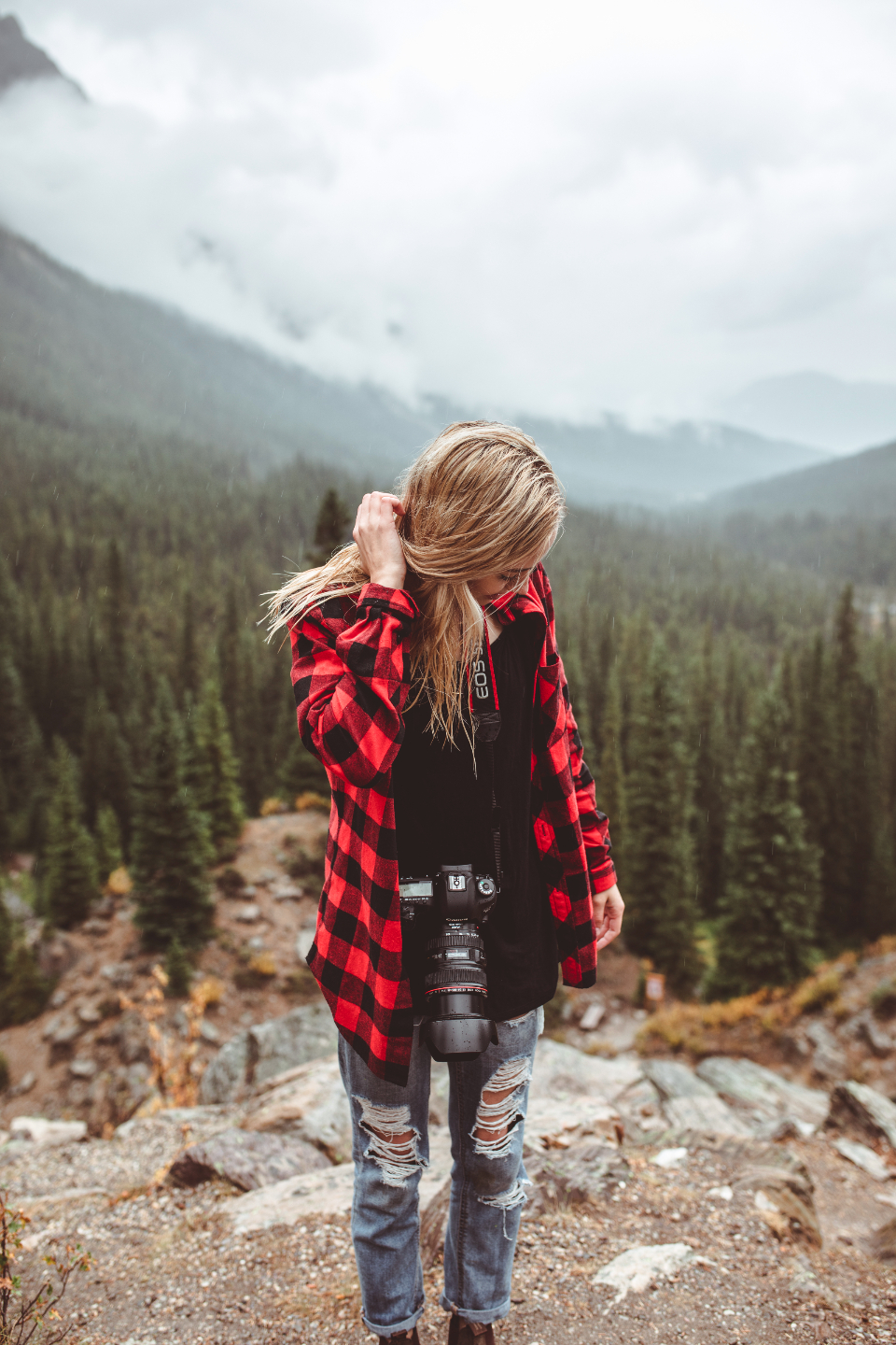girl blonde woman hair camera photographer hipster flannel mountains mountain nature earth trees forest