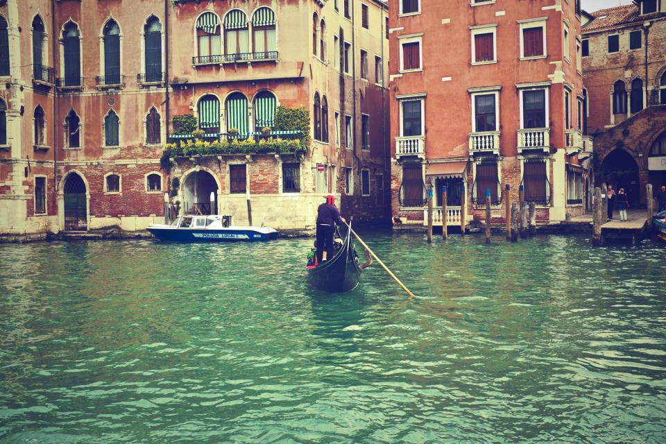 gondola Venice Italy water boats houses apartments city buildings architecture
