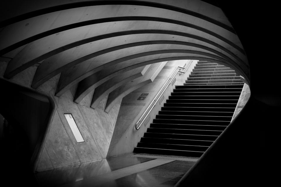 architecture infrastructures subway tube underpass train station platform stairs city urban metro patterns arches lines black and white