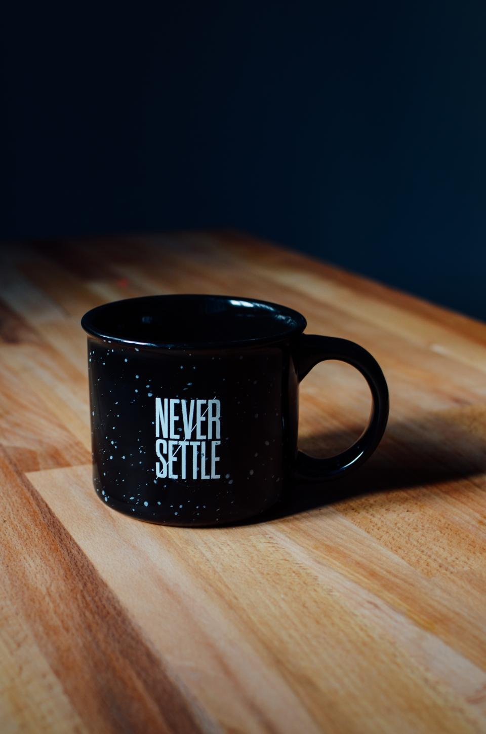 quote statement cup mug black table wood