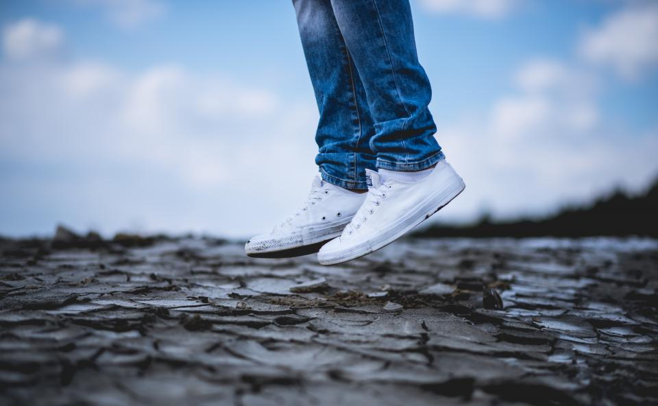 white shoe sneakers land jump jeans