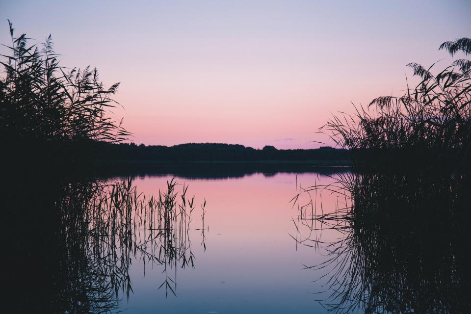 lake water reflection grass plant nature mountain sky sunset