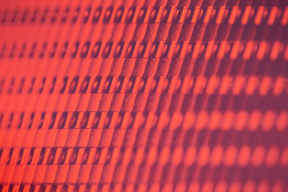 red futuristic abstract texture pattern close up macro cyber squares background light plastic auto automotive vehicle