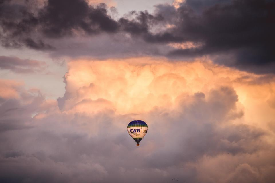 hot air balloon cloudy sky sunset