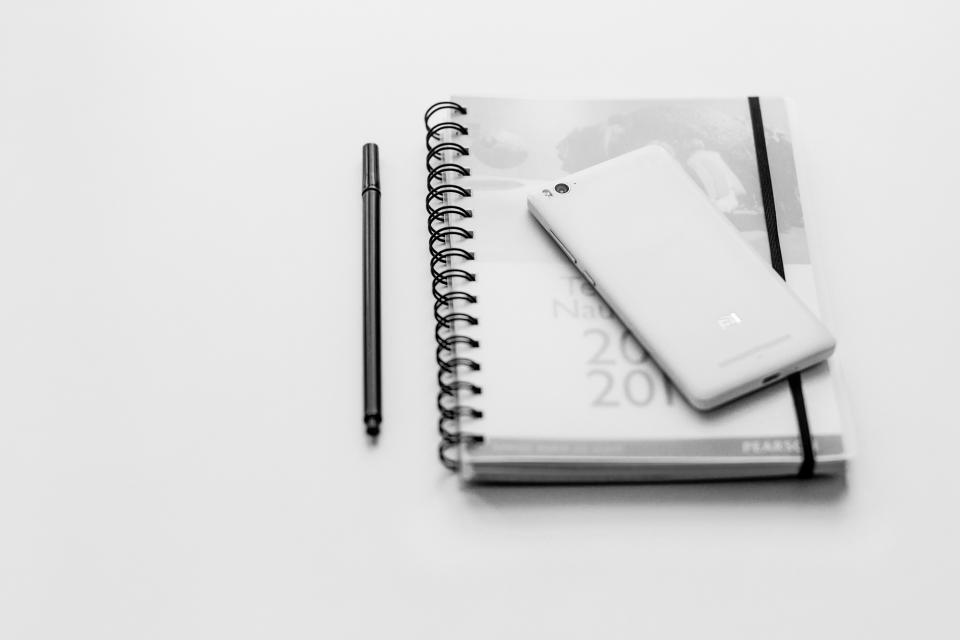 black and white notebook pen