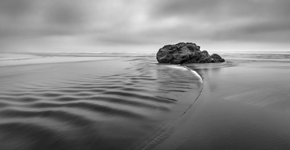 black and white rock sea