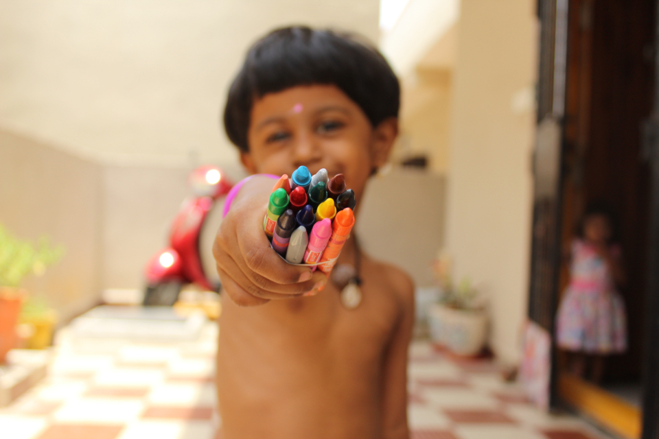 child colored crayons