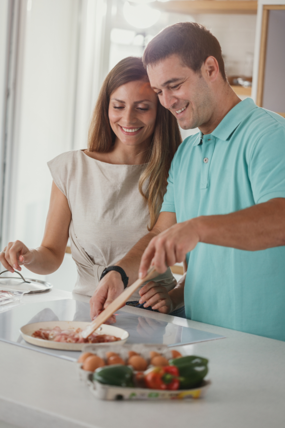 couple cooking kitchen