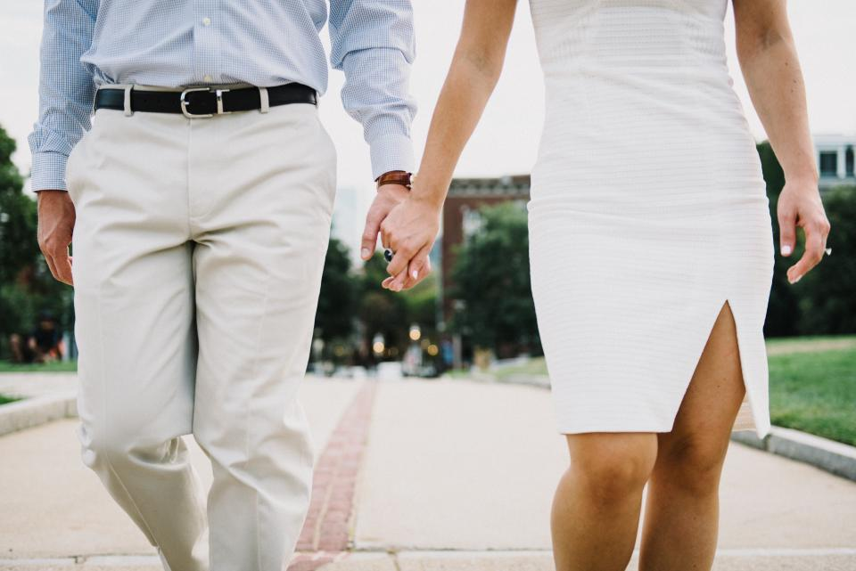 couple white holding hands