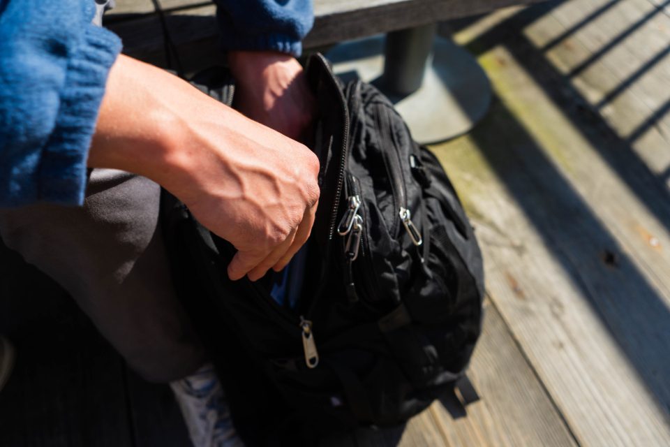 hands backpack travel